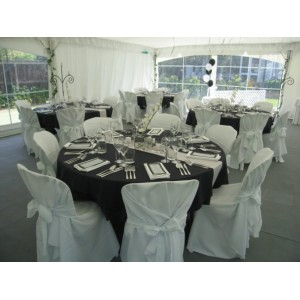 Formal dinner setting done in black, silver & white theme.