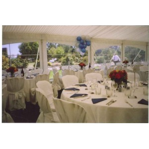 Table setting - Round Tables, White Linen and Covers
